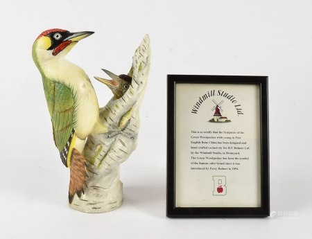 A limited edition bone china woodpecker, produced for Bulmer's Green Woodpecker Cider, with