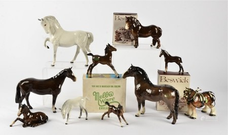A collection of Beswick horses, to include a white horse with front leg raised upwards, height 19cm,