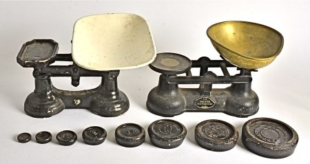 A set of Salter scales, together with one other and a set of six weights