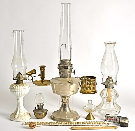 Three 20th Century oil lamps, with ceramic, glass and metal bodies, with shells and chimneys,
