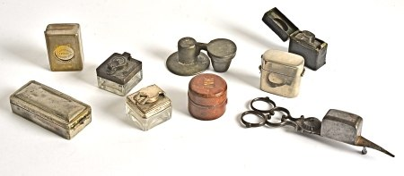 A selection of travelling ink bottles, glass, silver plated and gilt examples including one De La