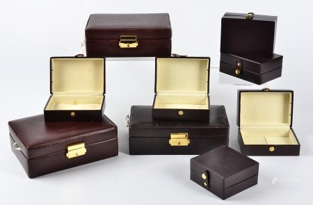 A large collection of jewellery boxes, red or brown leather covering with cream suede interior and