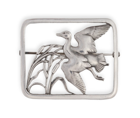 A SILVER BROOCH BY GEORG JENSEN, the rectangular-shaped frame enclosing a stylised bird in flight,