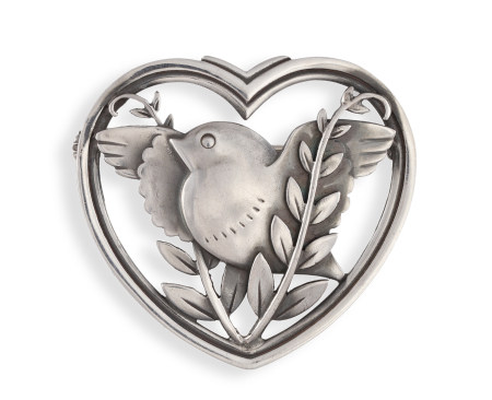A SILVER BROOCH BY GEORG JENSEN, CIRCA 1933-44, the heart-shaped frame enclosing a stylised bird