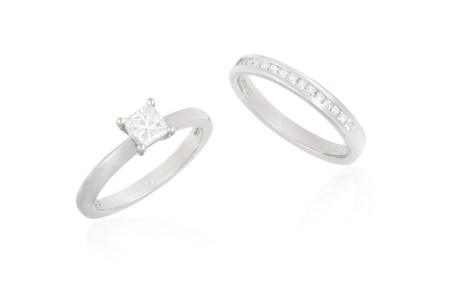 A DIAMOND RING AND A HALF HOOP ETERNITY RING, the solitaire ring set with a princess-cut diamond