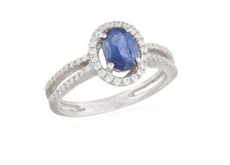 A SAPPHIRE AND DIAMOND RING, the oval-shaped sapphire within a surround of round brilliant-cut