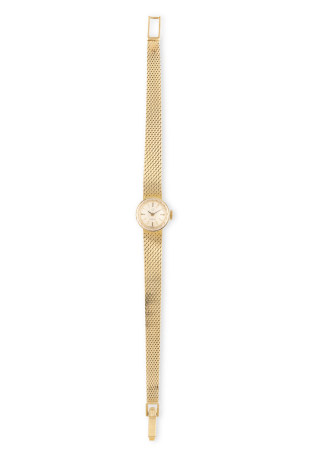 A LADY'S GOLD WRISTWATCH BY OMEGA, silver dial with baton hour markers, to a mesh-link bracelet,