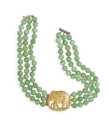 A JADE JADEITE NECKLACE, composed of three rows of jadeite beads, to a 9K gold frontispiece