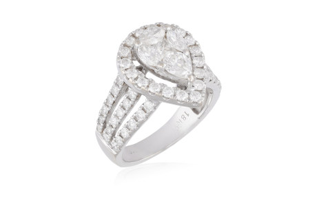 A DIAMOND DRESS RING, composed of a pear-shaped plaque set with a marquise, pear and princess-cut