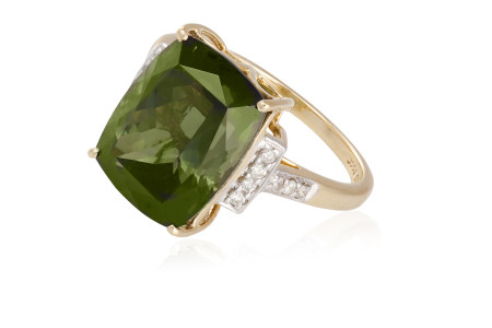 A TOURMALINE AND DIAMOND COCKTAIL RING, the fancy-cut green tourmaline between round brilliant-cut