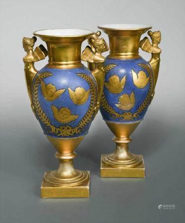 A pair of 19th century Paris porcelain two-handled vases,
