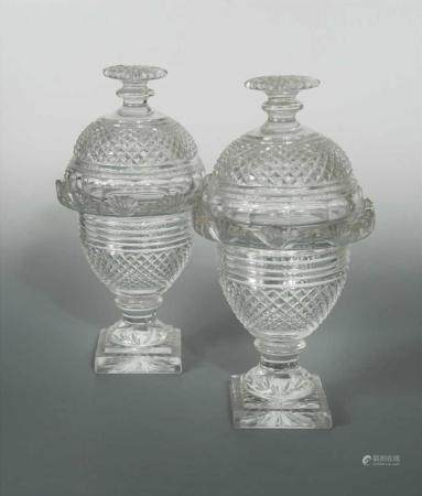 A pair of Irish Regency glass vases and covers,