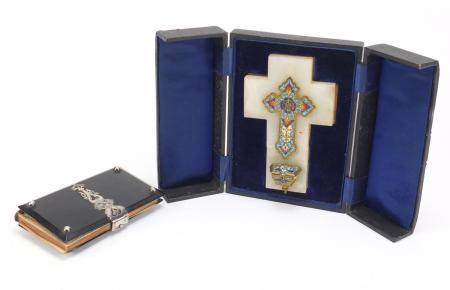 Gilt brass and enamel crucifix with fitted case and a silver mounted prayer book with vellum