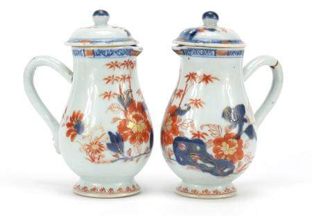 Pair of Chinese porcelain chocolate pots and covers, each hand painted in the Imari palette with