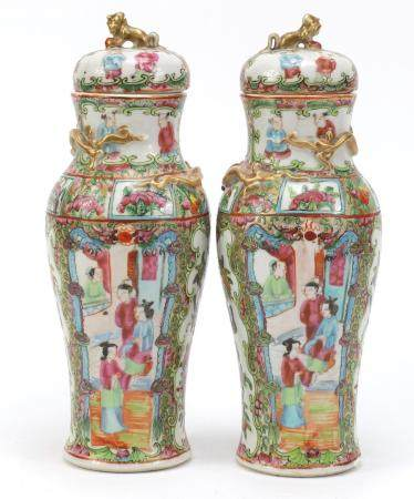 Pair of Chinese Canton porcelain baluster vases and covers, hand painted in the famille rose palette