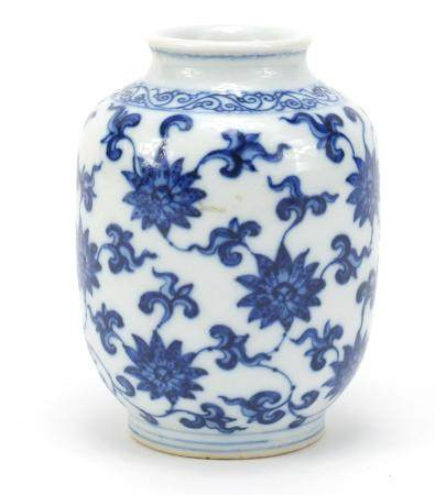 Chinese blue and white porcelain vase, finely hand painted with flower heads and foliage, six figure