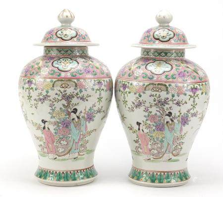 Pair of Chinese porcelain baluster vases and covers, each hand painted in the famille rose palette