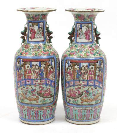 Large pair of Chinese Canton porcelain vases, each hand painted in the famille rose palette with
