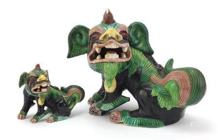 Pair of Chinese famille verte Foo dogs, one with impressed mark, each inscribed Staffs to the