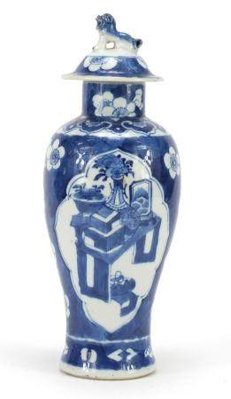 Chinese blue and white porcelain baluster vase with cover, hand painted with lucky objects onto a