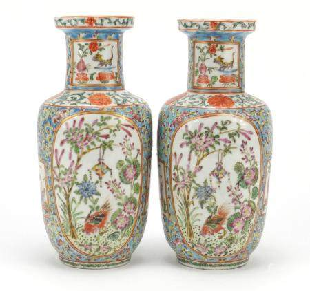 Pair of Chinese Canton porcelain vases, hand painted in the famille rose palette with figures, birds