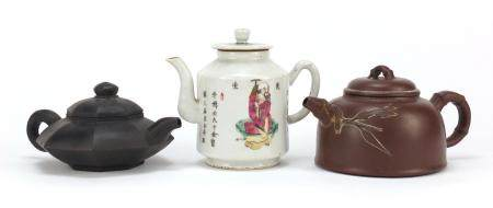Three Chinese teapots including two Yixing terracotta examples, the largest 12.5cm high :For Further