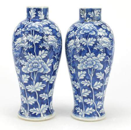 Pair of Chinese porcelain vases hand painted with dragons amongst flowers, each 27cm high :For