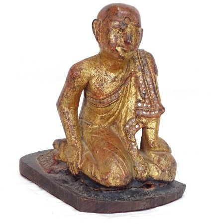 A Buddhist carved painted and giltwood kneeling monk figure, height 21cm