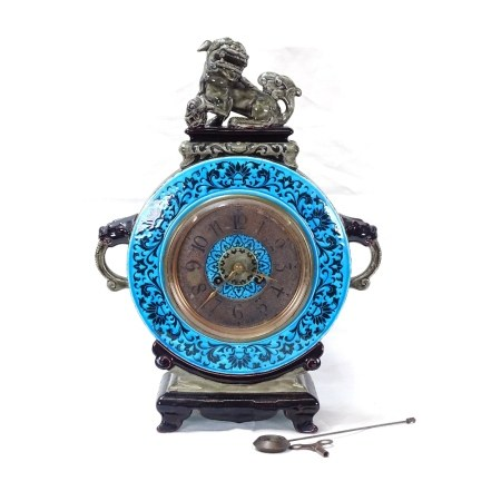 A French Aesthetic Movement Majolica Clock, turquoise and green glaze case in Chinese taste with Dog