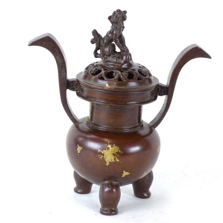 A Chinese polished bronze 2-handled censer, mark on base the dog knop, overall height 14.5cm