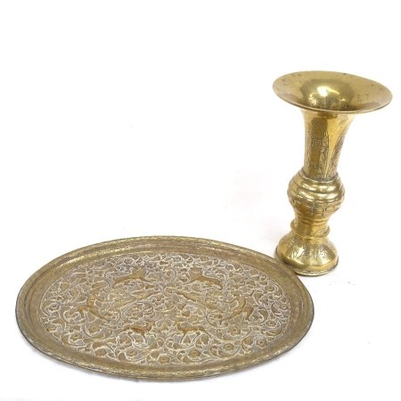 An Oriental cast-brass Gu vase, and an Indo-Persian relief embossed brass tray, vase height 27.