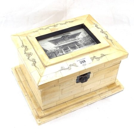 A modern Chinese carved and engraved bone panel casket, with inset postcard panel lid, length 27cm