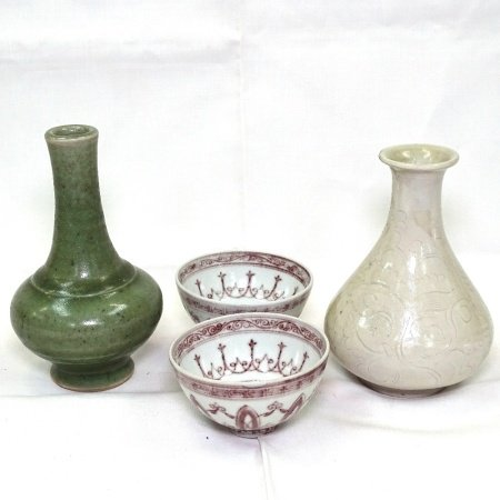 A group of Chinese porcelain items, including a white glaze narrow-neck vase with incised