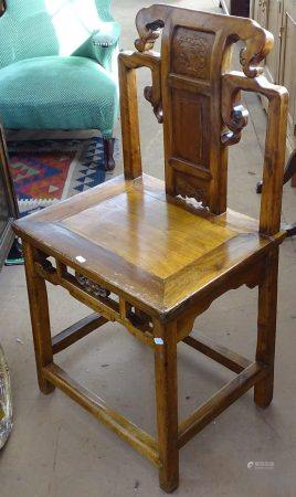 A Chinese elm altar chair, with carved decoration, seat width 50cm