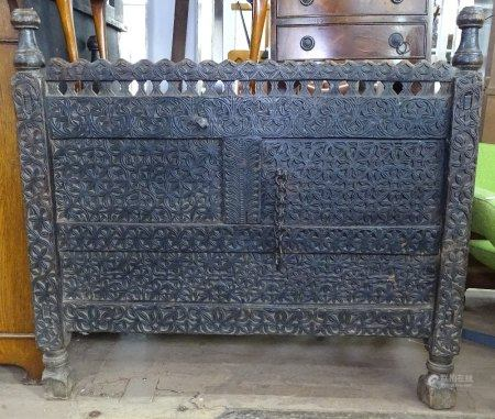 An Antique Korean marriage chest, with all over chip carved decoration, W110cm, H101cm, D59cm