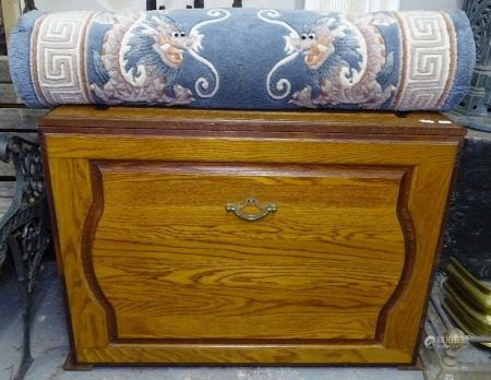 A Chinese style embossed runner, and an oak blanket chest