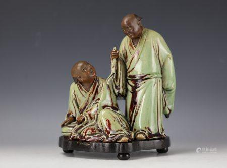 A Chinese Shiwan Porcelain Statue