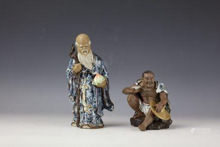 Two Chinese Shiwan Porcelain Statues