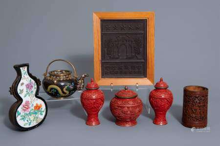 A varied collection Chinese items: a tea block, a cloisonné teapot, a wall vase, a bamboo brush pot and three red lacquer vases, 20th C.