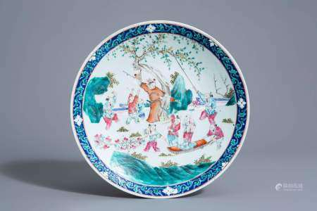 A Chinese famille rose charger with playing boys in a garden, 19th C.