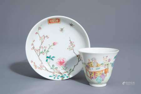 A Chinese famille rose cup and a saucer with different designs, 19th/20th C.