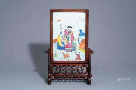 A Chinese wooden table screen with a famille rose plaque with the three star gods, 19th C.