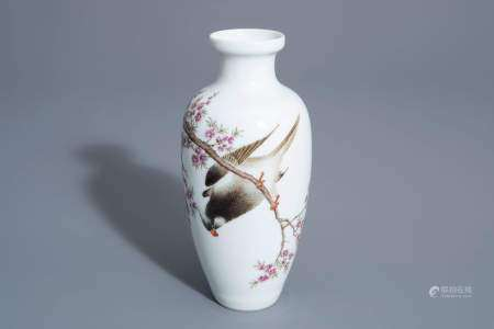 A Chinese famille rose vase with a bird among a flowering branch, 20th C.