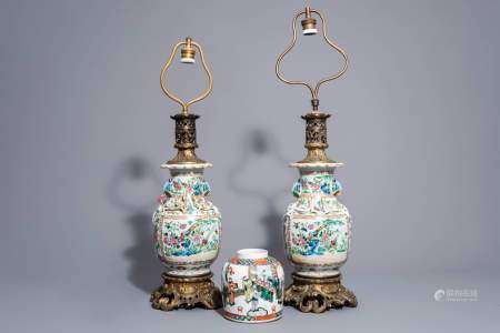 A pair of Chinese Canton famille rose vases mounted as lamps and a famille verte jar, 19th C.