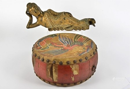 A East Asian reclining figure, heightened in gilt, length 42cm, together with an Oriental drum,