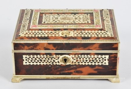 A bone and tortoiseshell box, of Indian origin, raised on four feet, the interior with mirror and