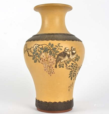 A Japanese terracotta vase, with incised decoration of a pair of birds perching on a branch,