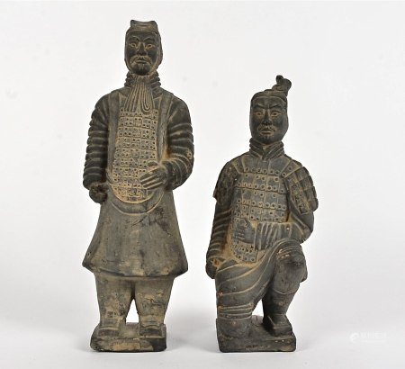 Two Chinese terracotta tomb figures, one standing and one crouching on one knee, heights 27cm and