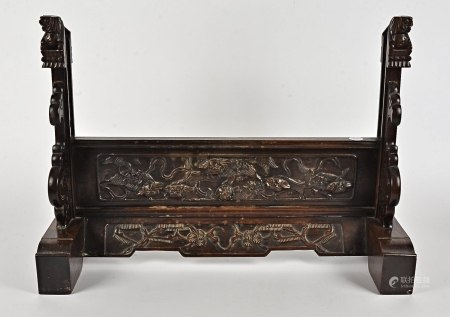 A Chinese hardwood framed stand, with carved decoration of flowers and temple dogs, 62.5cm x 45cm