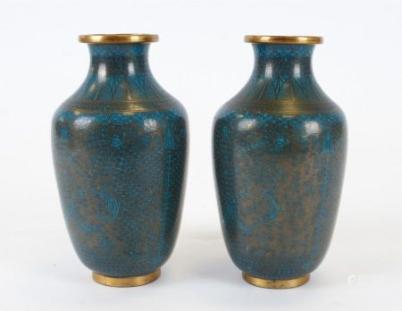 A pair of Asian cloisonné enamel vases, with uniform turquoise colouring, the intricate metalwork